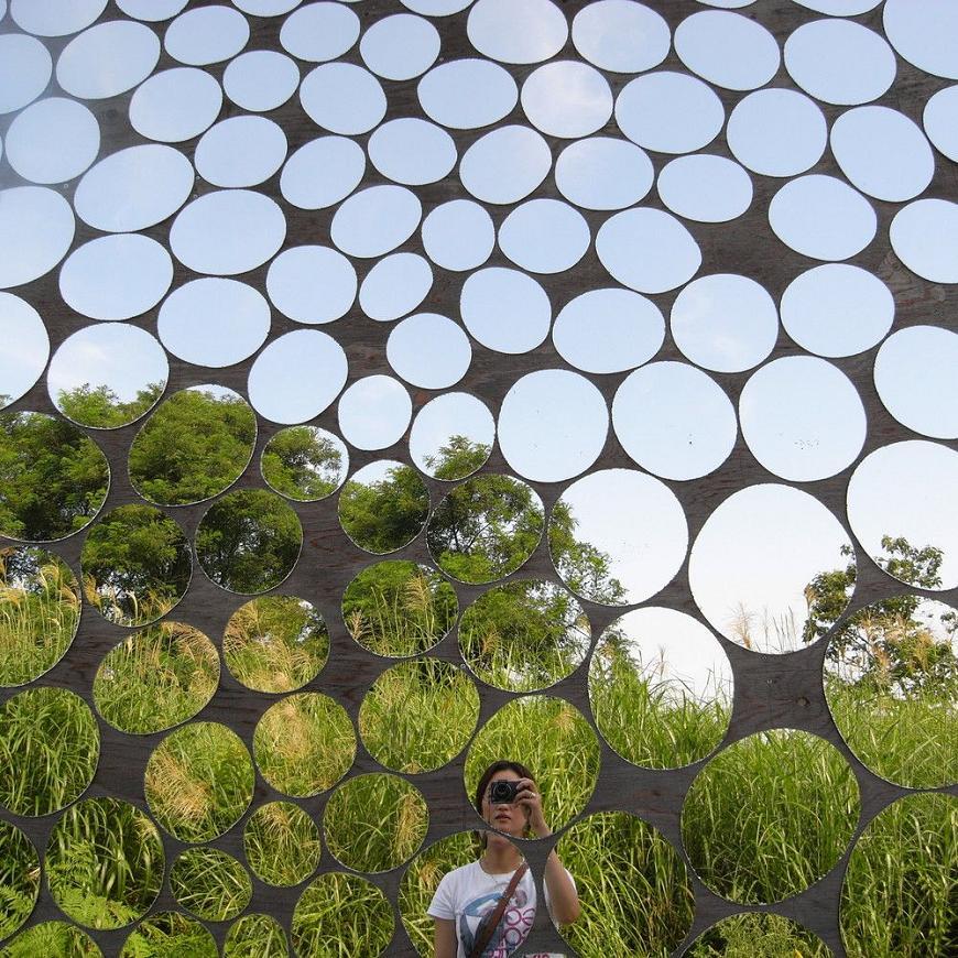 Circular mirrors house